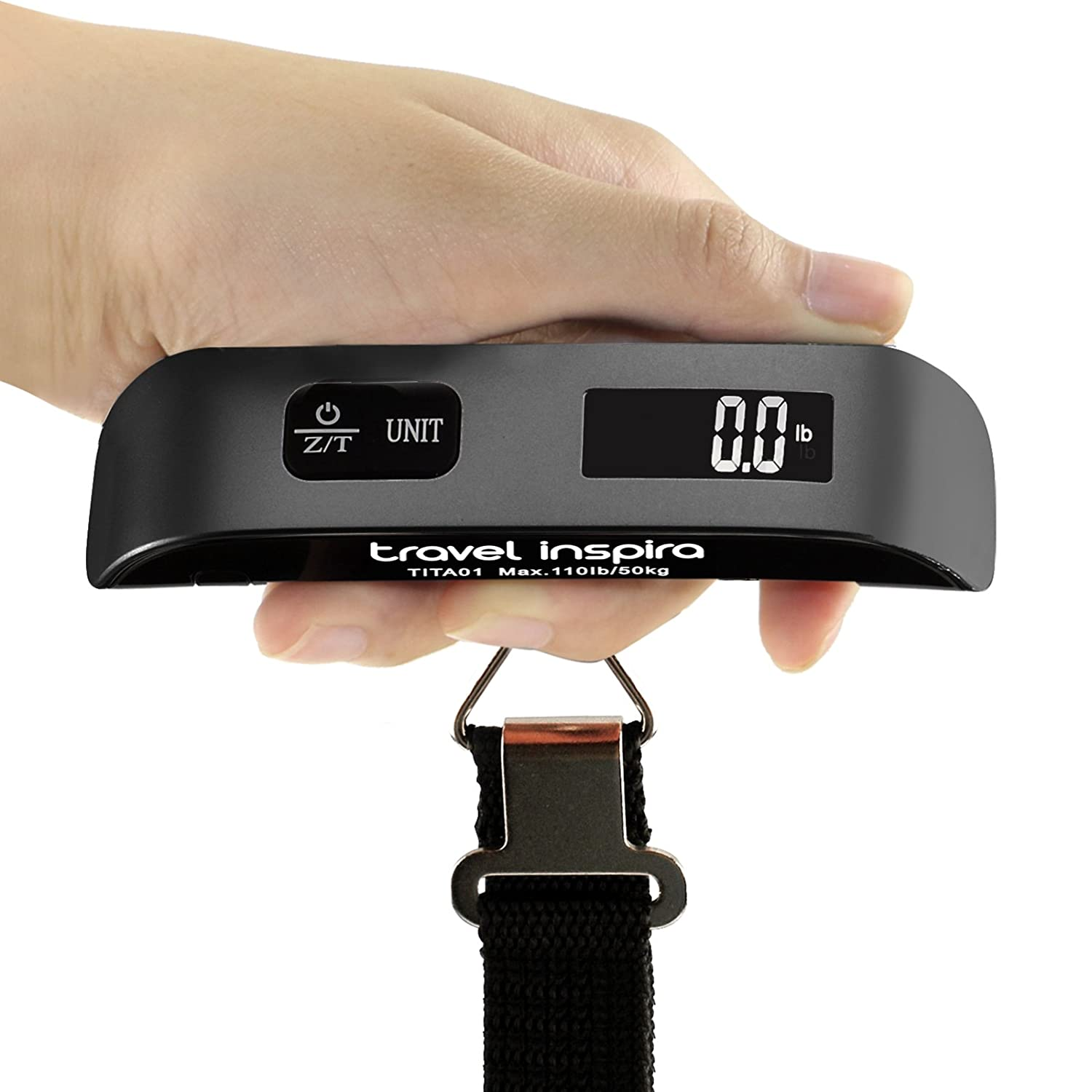 This is an image of a digital luggage scale with a hand holding it.