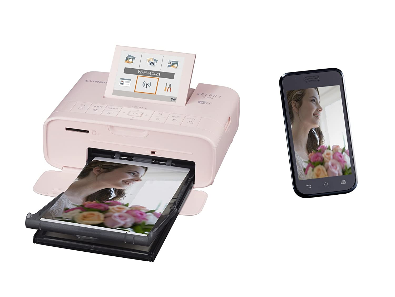 Canon Selphy CP1300 - Impresora fotográfica inalámbrica (Apple AirPrint, Mopria, pantalla abatible de 8.1 cm, tintas de 3 colores, 300 x 300 ppp) rosa