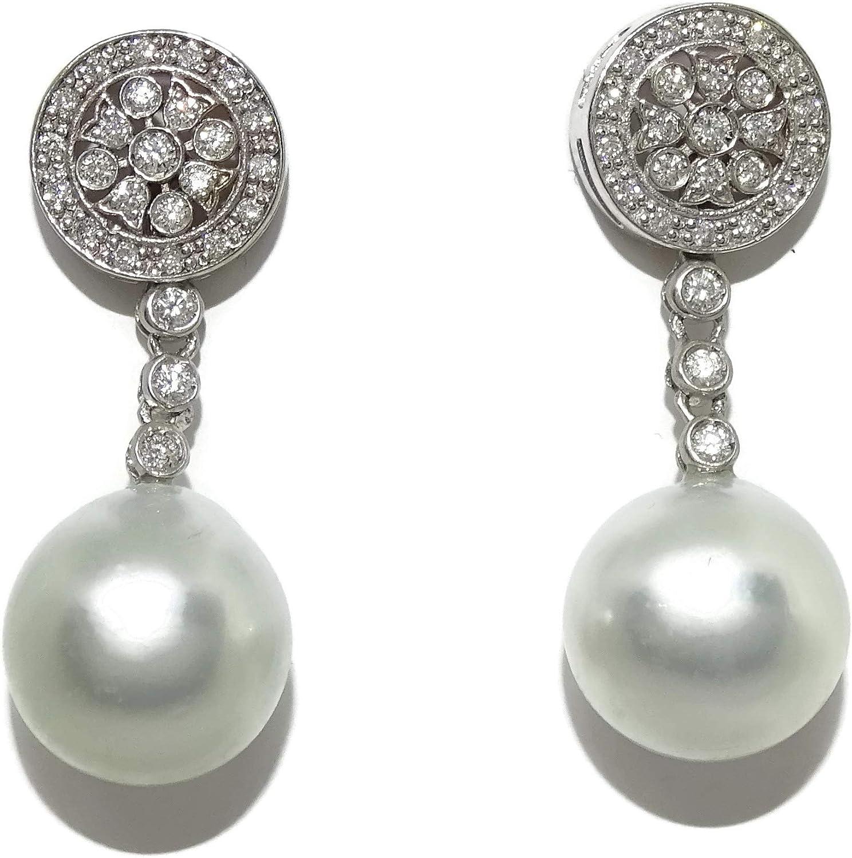 Pendientes de diamantes de 0.49cts y perlas australianas de 11.5mm en oro blanco de 18k. Cierre presión