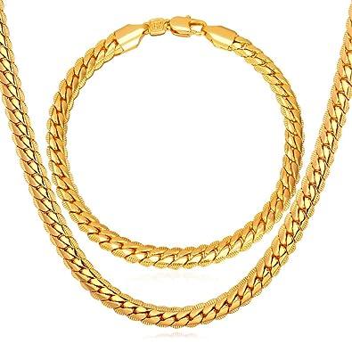757c6d50c153 Set exclusivo para crear un look diferente y elegante. Ambas piezas están  elaboradas con oro de 18K. Collar suelto de 24 pulgadas y brazalete de 8.3  ...