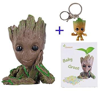ee40d3163344 Baby Groot Maceta Figura de acción con forma de maceta y lápiz para niños  Figuras de la olla de Galaxy Modelo de bebé lindo Juguete Pen Pot:  Amazon.es: ...