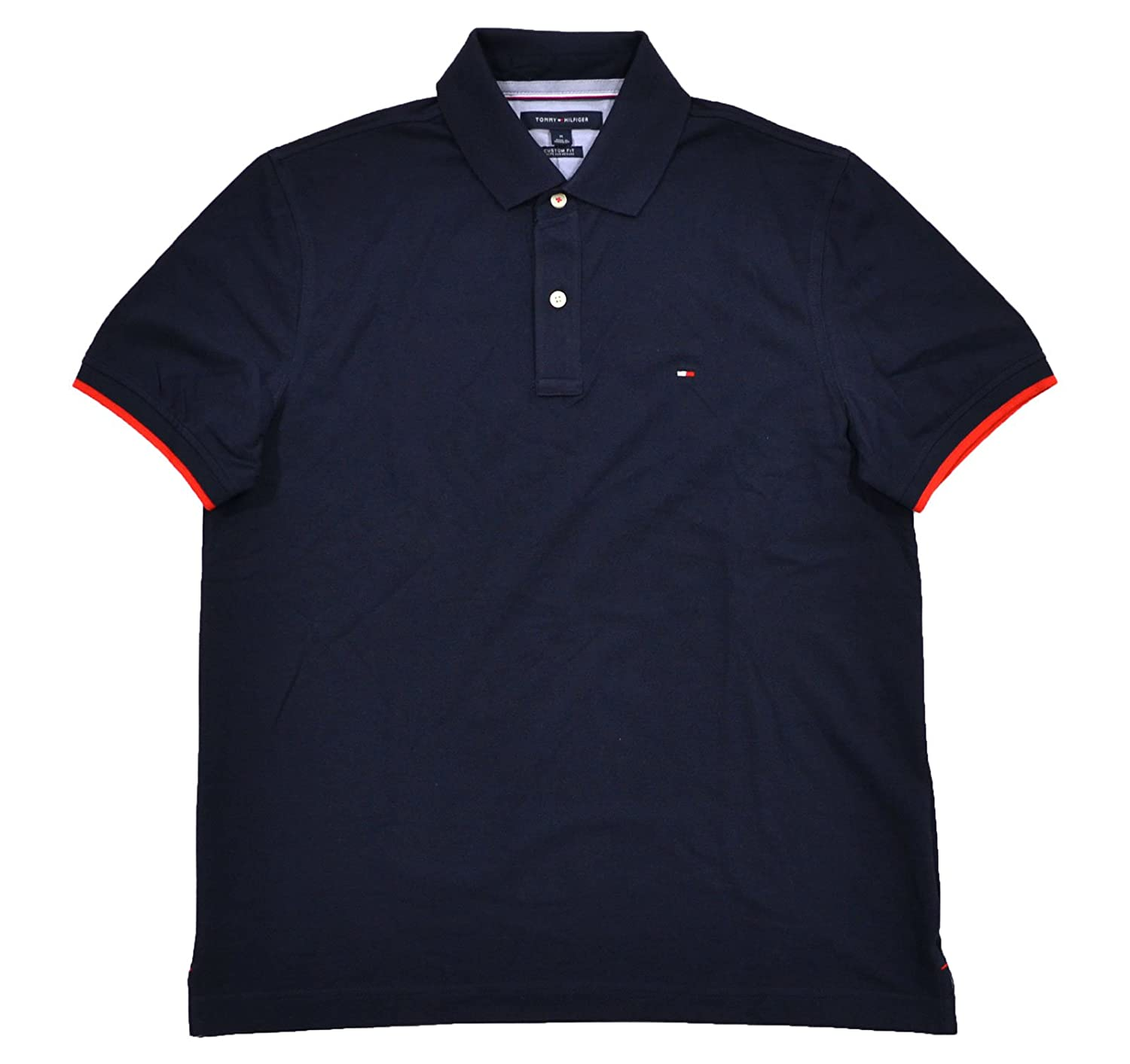 6ca0411c5 Tommy Hilfiger is the pinnacle of fashion and design. This mesh polo shirt  comes in a custom fit and has a contrasting color collar.