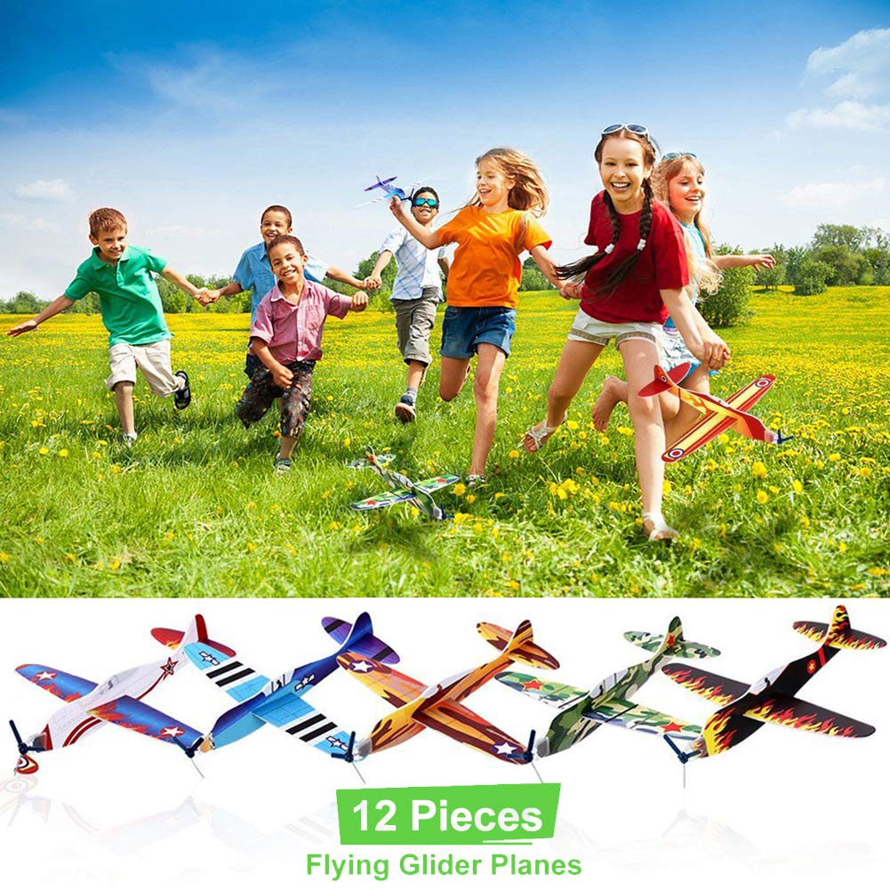 12 Pcs Flying Glider Planes with 10 Assortment of Mini Toy for Kids Birthday Party Favors Including Water Beads Mini Dinosaurs Whistles Eyes Finger Puppet Carnival Prizes School Classroom Rewards