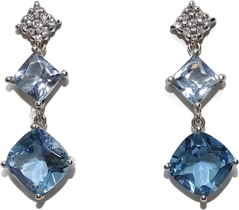 Preciosos y largos pendientes con diamantes 0.28cts de diamantes y 7.76cts de topacios azules. Largos 3.10cm. Cierre presion