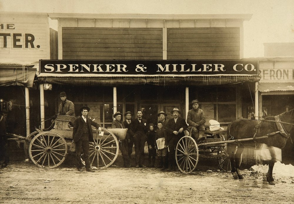 Mercantile Operation In Goldfield During The Heyday The Outside Photograph Is The Front Of The Store With Many People Standing Outside With There Delivery Wagons Poster Print by Allen Photo Company 2