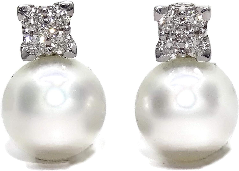 Preciosos pendientes de oro blanco de 18k con 0.58 cts de diamantes y perlas australianas de 12mm. Cierre omega.