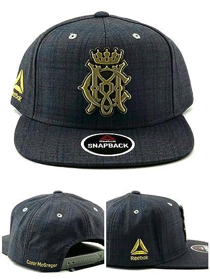 c673cddb798 Amazon.com   Reebok Conor McGregor Plaid Snapback Hat   Sports   Outdoors