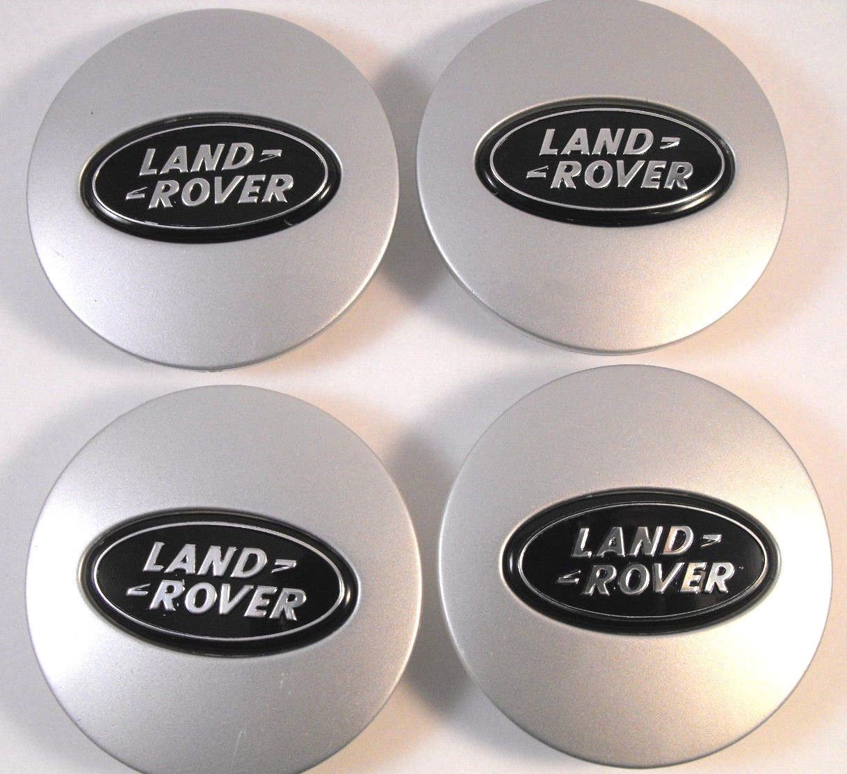 4X Land Rover 63Mm hub caps hub caps wheel caps lid caps silver / black logo badgedirect