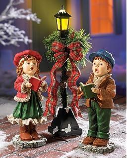 whimsical kids singing caroler lighted lamp post lantern boy girl caroling christmas patio porch indoor holiday