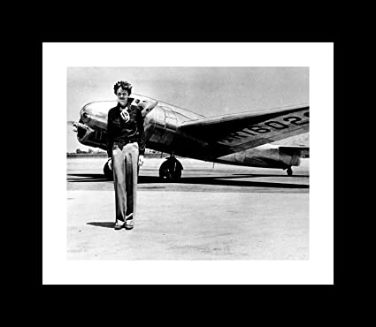 Amazon.com: Amelia Earhart By An Airplane - Framed 10\