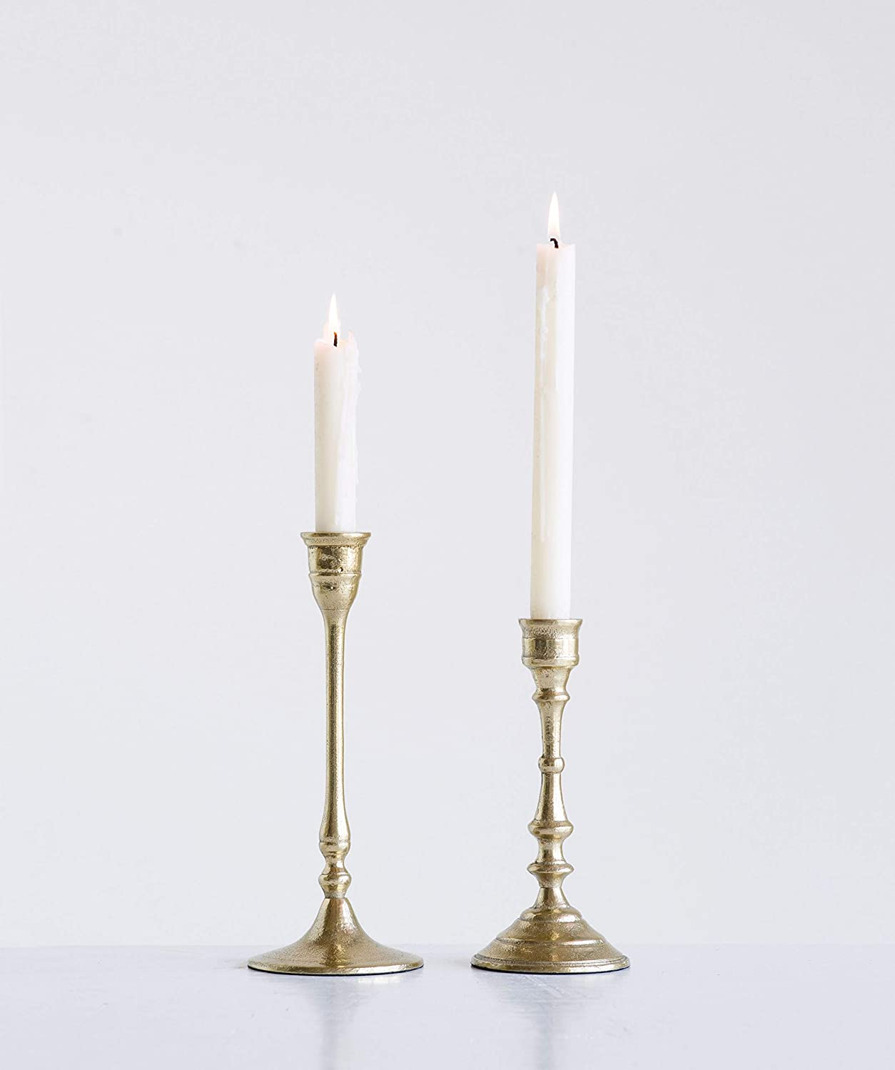 Aluminum taper candle holders with gold finish for a vintage style dining table or farmhouse style mantel.