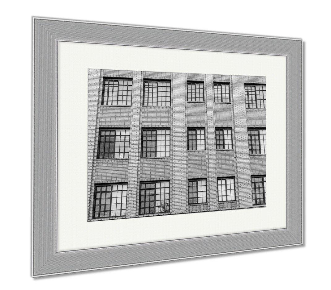 Ashley Framed Prints Many Blue Windows On Brick Highrise Building, Contemporary Decoration, Black/White, 26x30 (frame size), Silver Frame, AG6564319