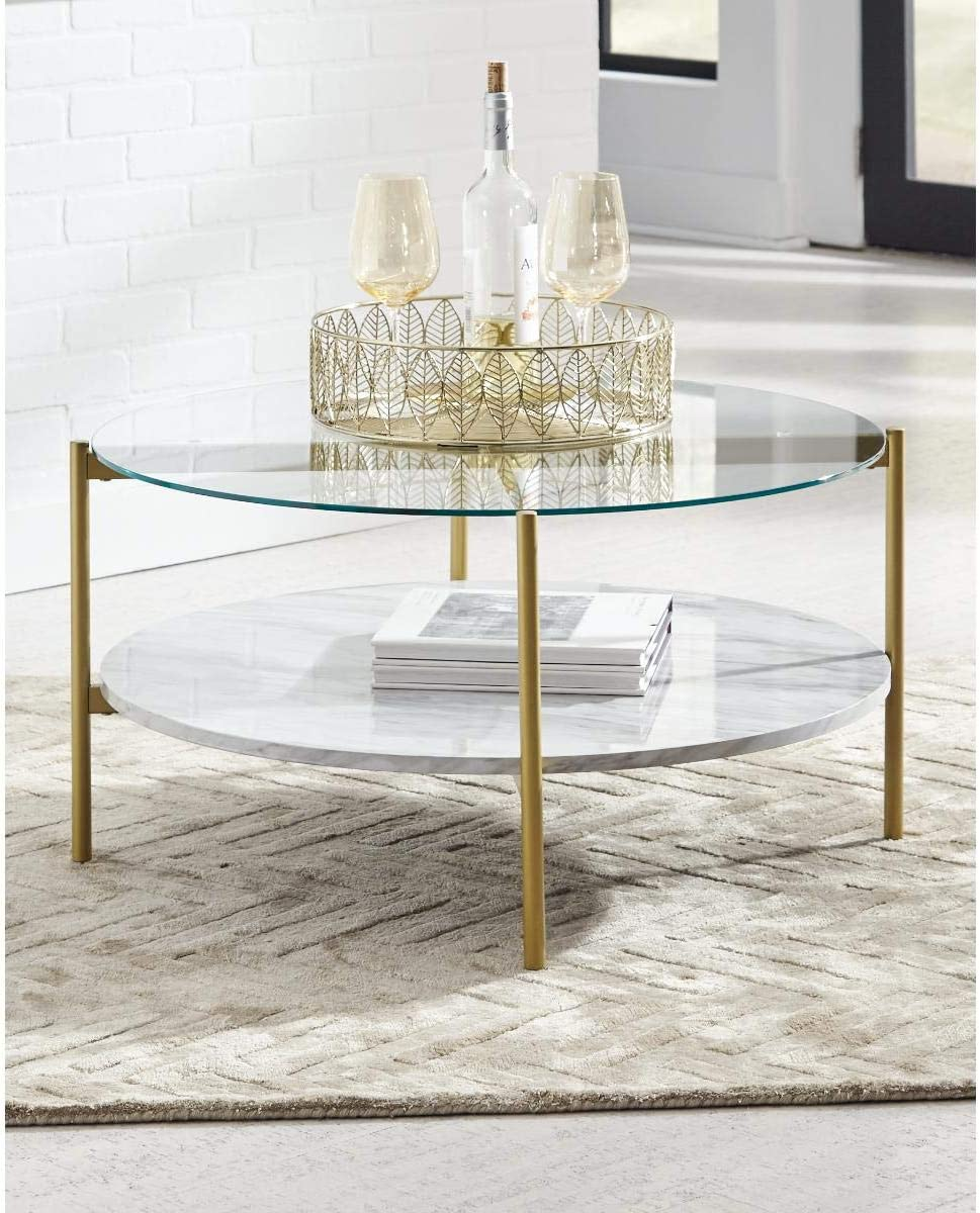 Signature Design by Ashley - Wynora Round Glass Top Coffee Table w/ Fixed Shelf, White Faux Marble/Gold