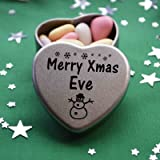 Merry Xmas Eve Mini Heart Gift Tin with Chocolates Fits Beautifully in the palm of your hand. Great Christmas Present for Eve Makes the perfect Stocking Filler or Card alternative. Tin Dimensions 45mmx45mmx20mm. Three designs Available, Father Christmas, Snowman and Snowflakes. They also make perfect Secret Santa Gifts.