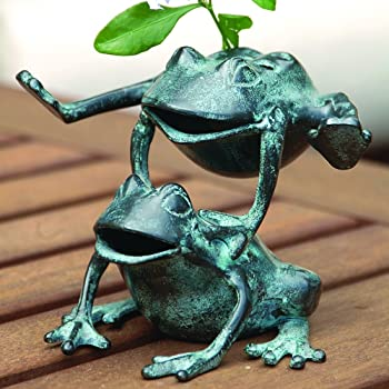 bronze frogs playing leapfrog