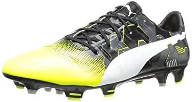 PUMA Men s Evopower 1.3 Graphic fg Soccer Shoe Safety Yellow White 10 ... 3da9c0d12516f