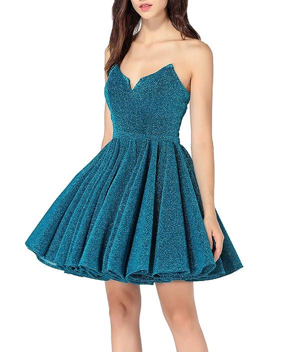 63b0bd294 Es un vestido para usar en una fiesta de noche. Está elaborado con tejidos  de punto y su diseño cuenta con una falda abultada de corte sobre las  rodillas