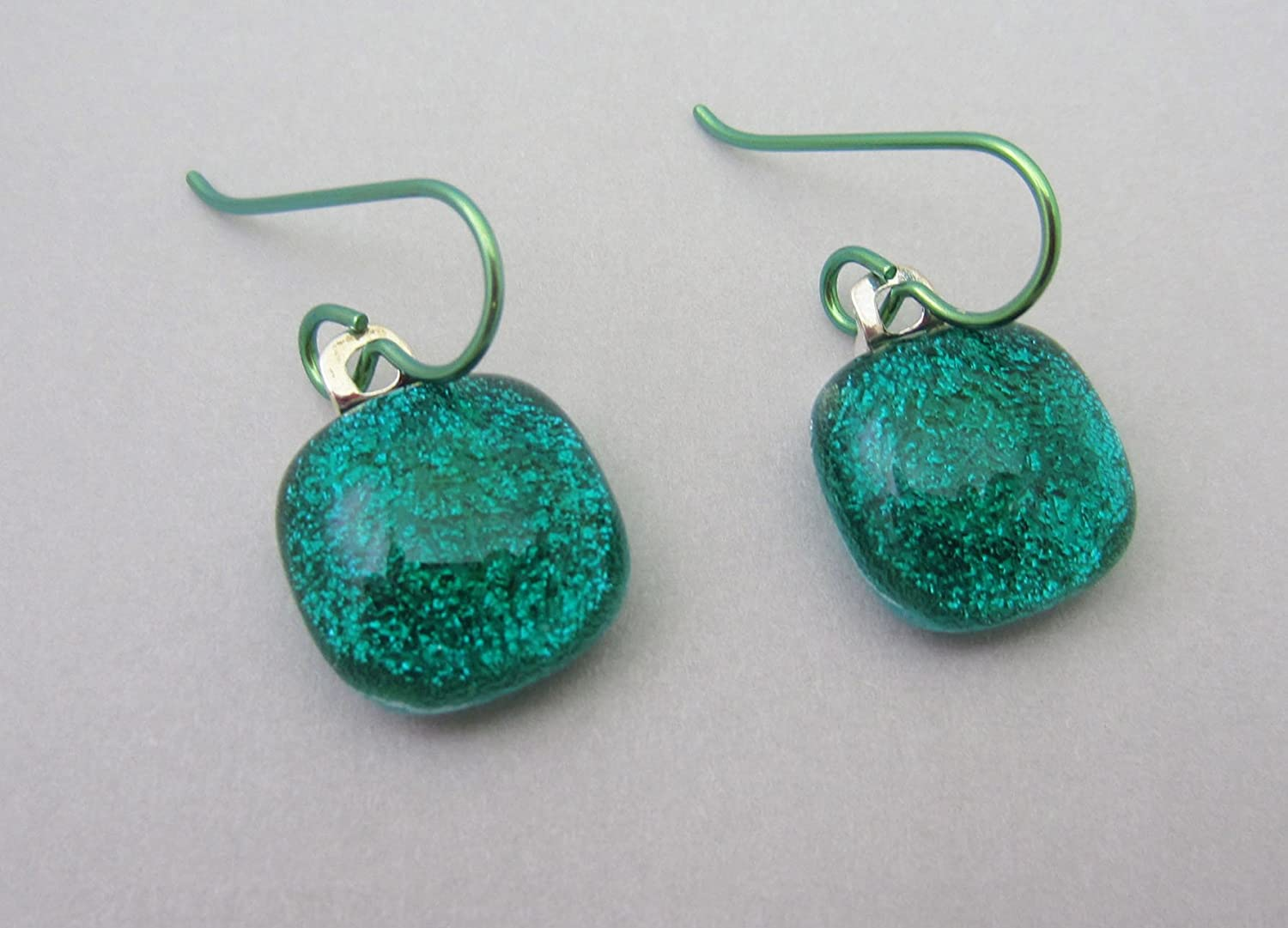 Bright emerald green drop fused dichroic glass earrings. Hypo-allergenic niobium ear wires