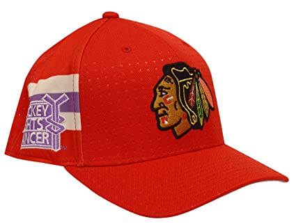 272a9b79daf Amazon.com   adidas Chicago Blackhawks Hockey Fights Cancer Flex Fit ...
