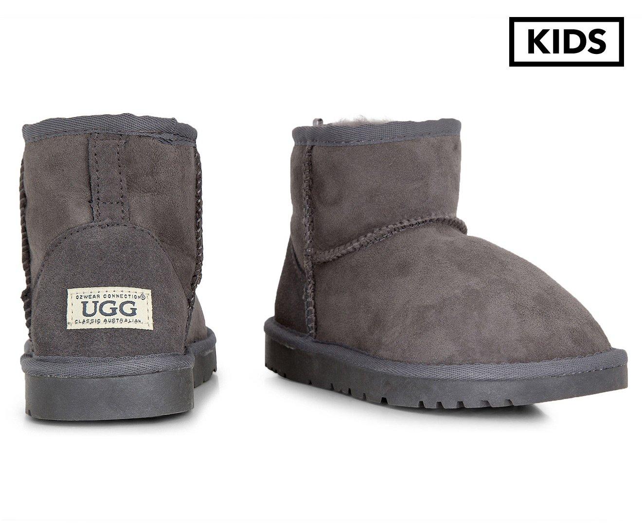 193011a2779 Ozwear Connection Kids  Mini UGG Boots Charcoal  Amazon.com.au  Fashion