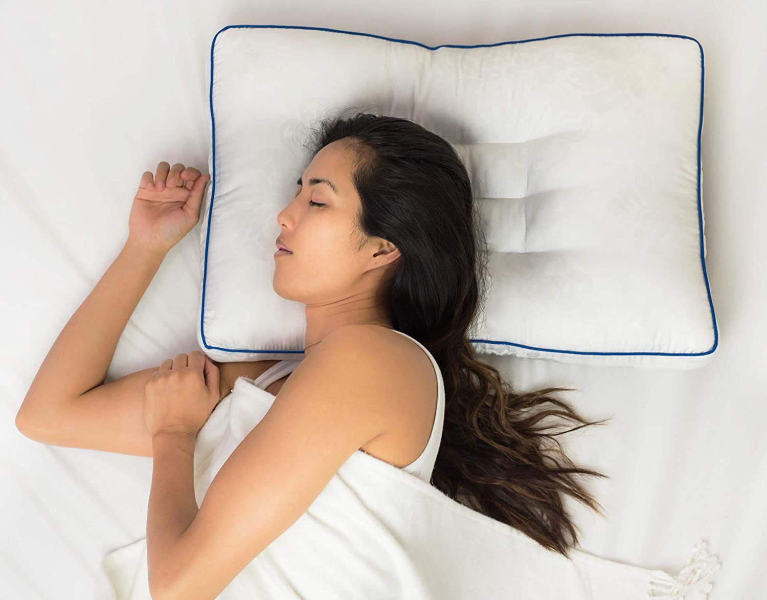 Identify the familiar sleeping posture and compare it with the essential features of the right pillow