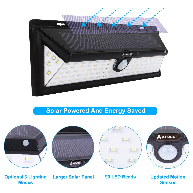 90LEDs 1000 Lúmenes Focos Solares con Sensor de Movimiento, Impermeable, Gran Ángulo 120°, Proporcionar hasta 12 HORAS Con 3 Modos Rango de Sensor 8-10m ...