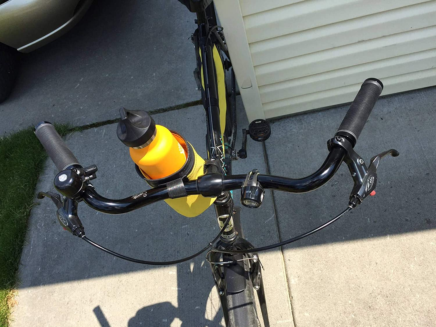 BUCKET handlebar mounted carrier for your water bottle or beverage made from used bike inner tubes