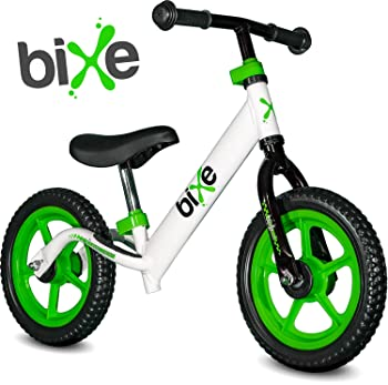 side facing green and white bixe extreme light balance bike