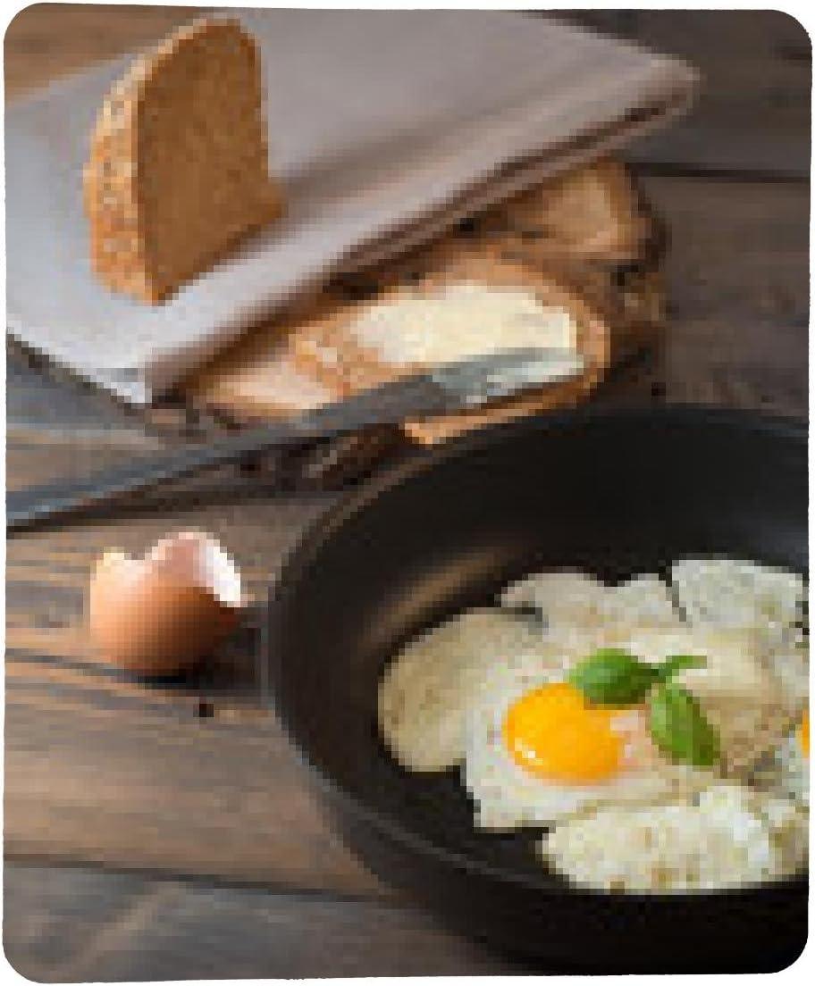 alfombrilla de ratón Frito en una sartén con pan integral ...