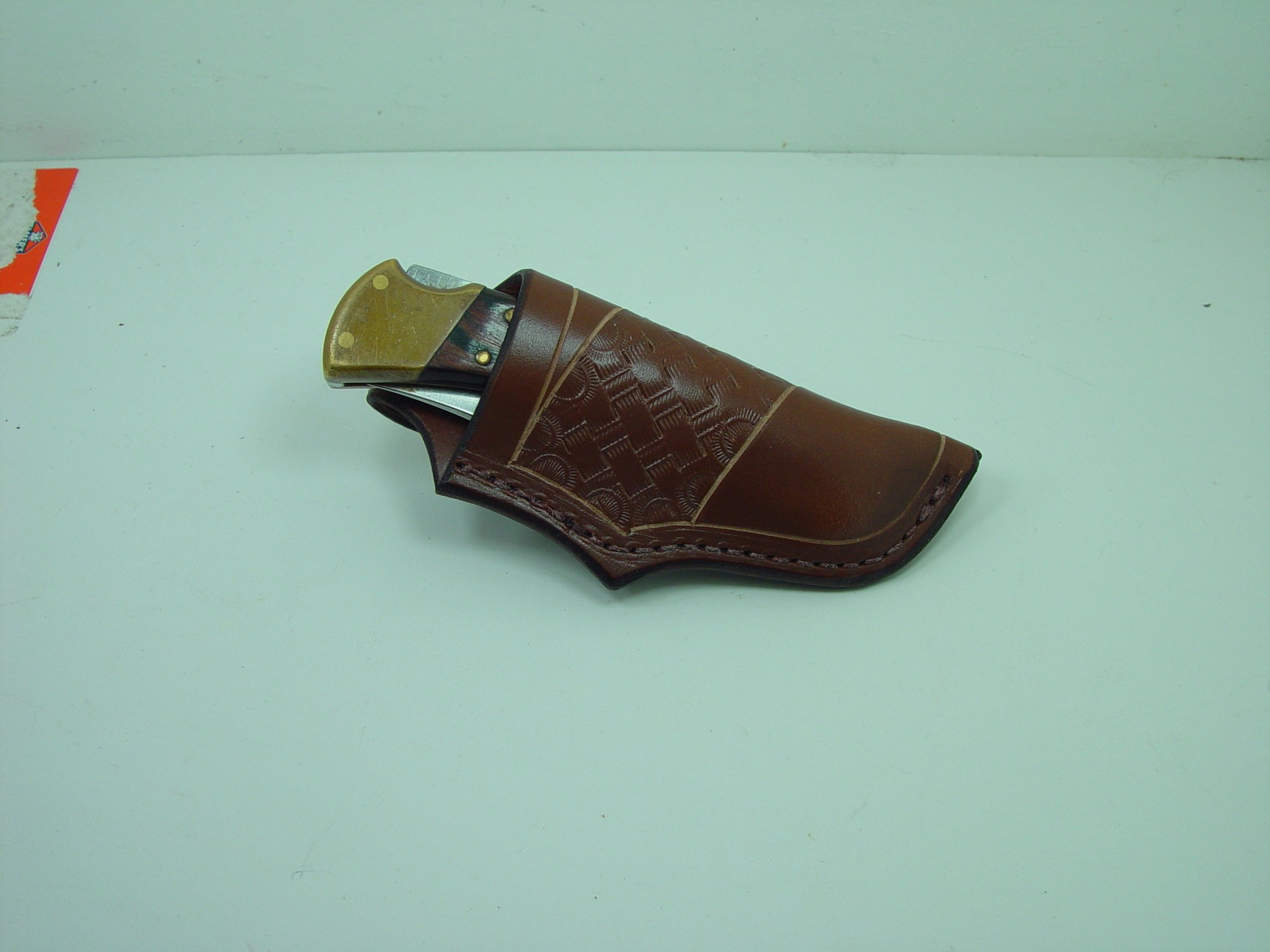 Buck 110 Folding Pocket Knife Sheath. The Sheath Is Made Out of 9 Ounce Leather. . The Sheath Is Died Light Brown with a Basket Weave Tooling. This I for Sheath Only Knife Not Included.