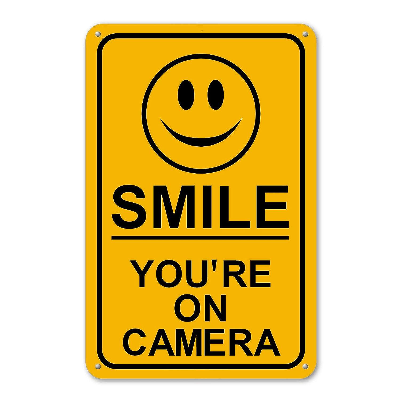 Smile estás en cámara Cartel Seguridad impermeable negocio amarillo video CCTV: Amazon.es: Jardín