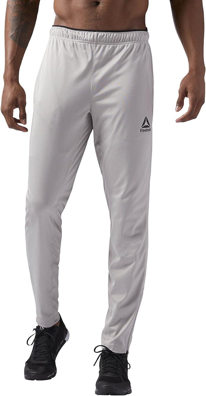 Reebok Trackster Pantalones de chándal, Gris, X-Large: Amazon.es ...