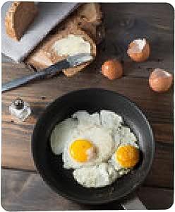 alfombrilla de ratón huevos fritos en una sartén con pan ...