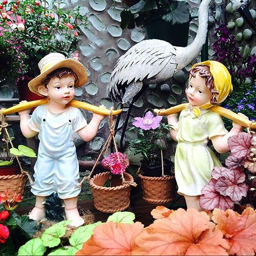 zenggp Jardín Decoración Escultura Al Aire Libre Jardín Paisaje Ornamento Figuras Niño Pequeño Y Niña Recogiendo Una Cesta De Flores: Amazon.es: Hogar