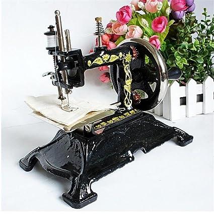 Antigua máquina de coser de simulación puede componer ropa pantalones Use tienda de ropa / café