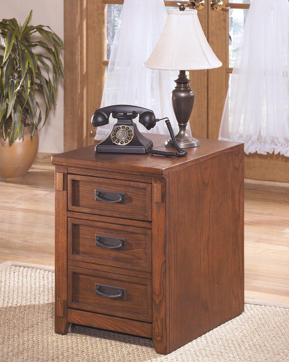 Ashley Furniture Signature Design - Cross Island File Cabinet - 1 Storage Drawer/1 File Drawer - Bronze-Tone Hardware - Medium Brown Finish H319-12