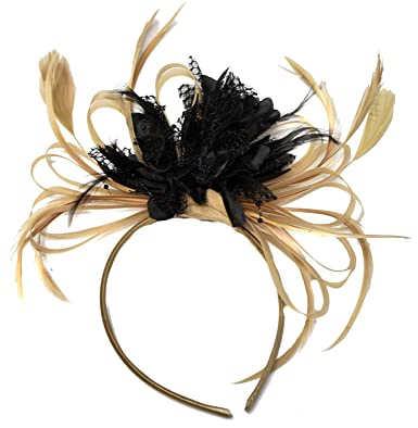 New big gold and black fascinator on a comb.
