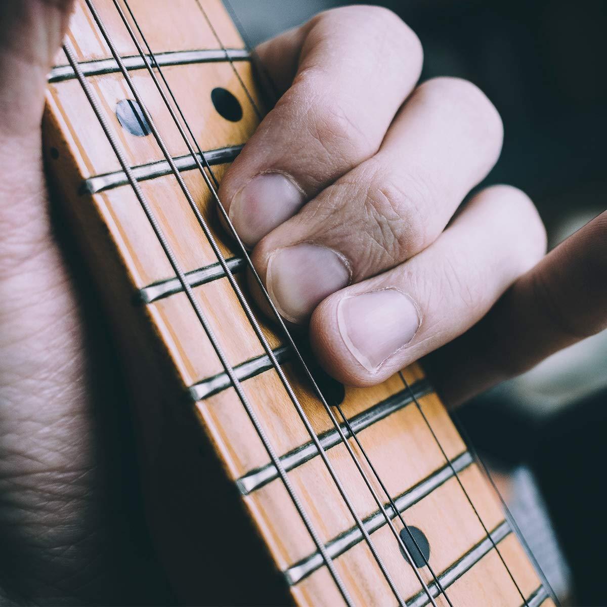 kwmobile Set de 6 cuerdas para guitarra - Juego de cuerdas de repuesto para guitarra acústica clásica - Cuerdas acero numeradas con div. grosor: Amazon.es: ...
