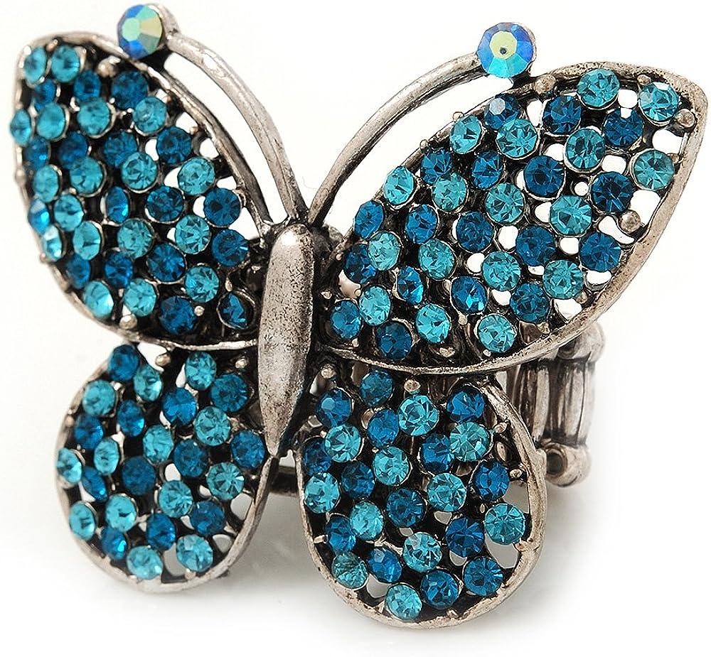 Avalaya - Anillo elástico de cóctel con diseño de mariposa incrustada con diamantes, chapado en rodio (cristales azules), tamaño ajustable 7/8