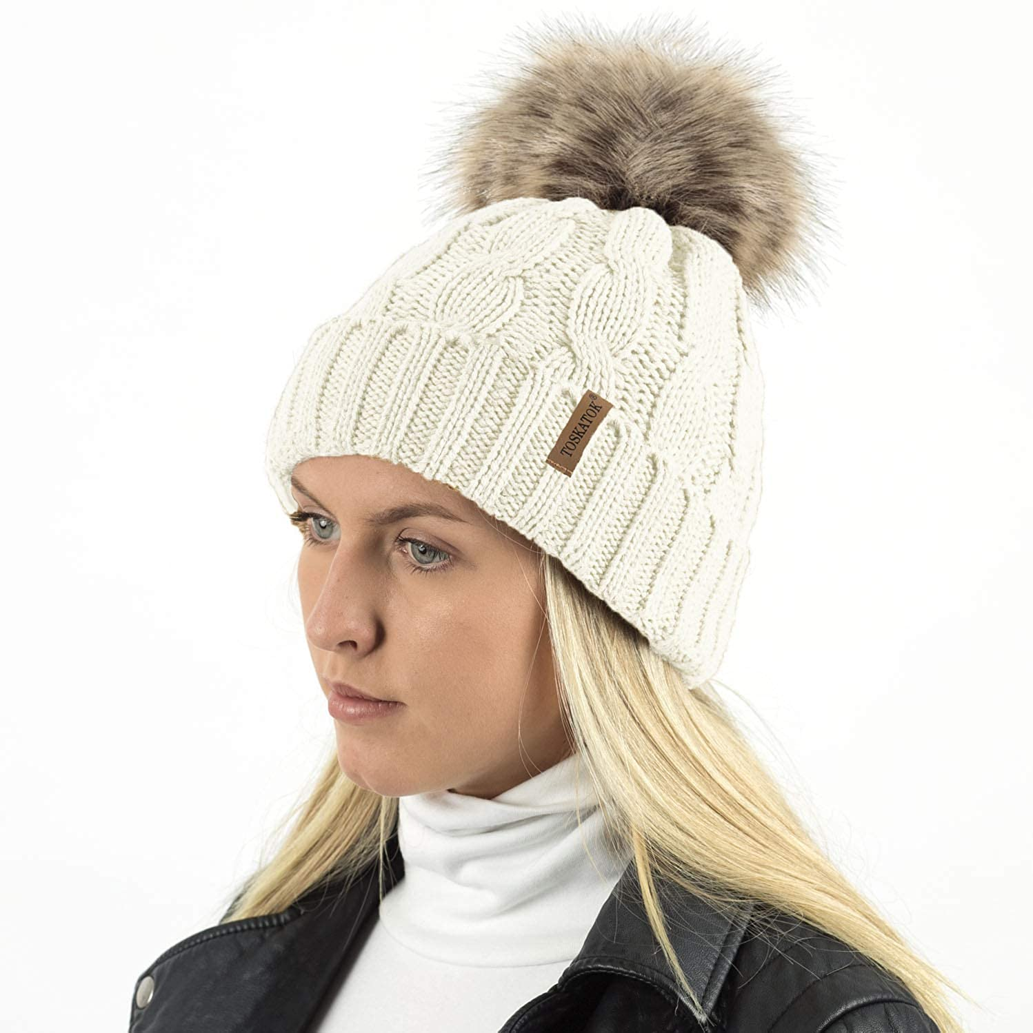 b1cd2e5f94b TOSKATOK® Ladies Chunky Soft Cable Knit hat with Cosy Fleece Liner and  Detachable Faux Fur Pompom-Cream  Amazon.co.uk  Clothing
