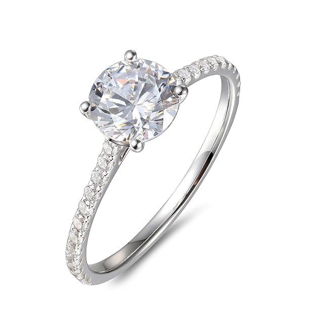 5e2516930f98 Este anillo delicado y atemporal está elaborado a mano con oro macizo de  14K. Su diseño viene con la mitad del círculo incrustada con brillante  circonio y ...