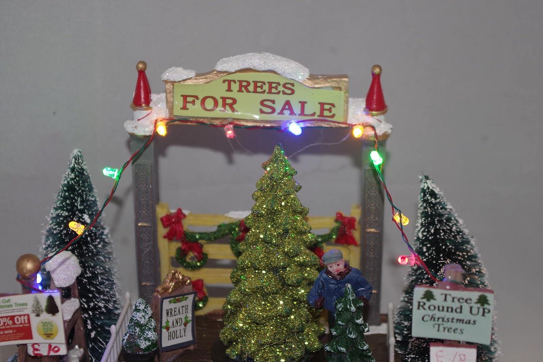 8990726e496 Escena de la aldea Navidad LED iluminan la ciudad decoración adorno de árbol  para la venta  Amazon.es  Iluminación