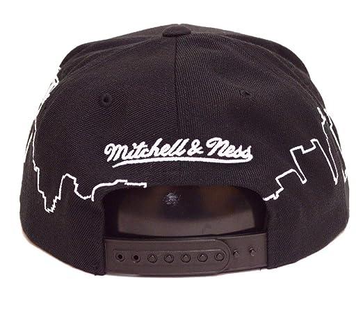 newest 84238 b2639 Amazon.com   Mitchell   Ness NBA City Scape Adjustable Snapback Hat Black  (Boston Celtics)   Clothing