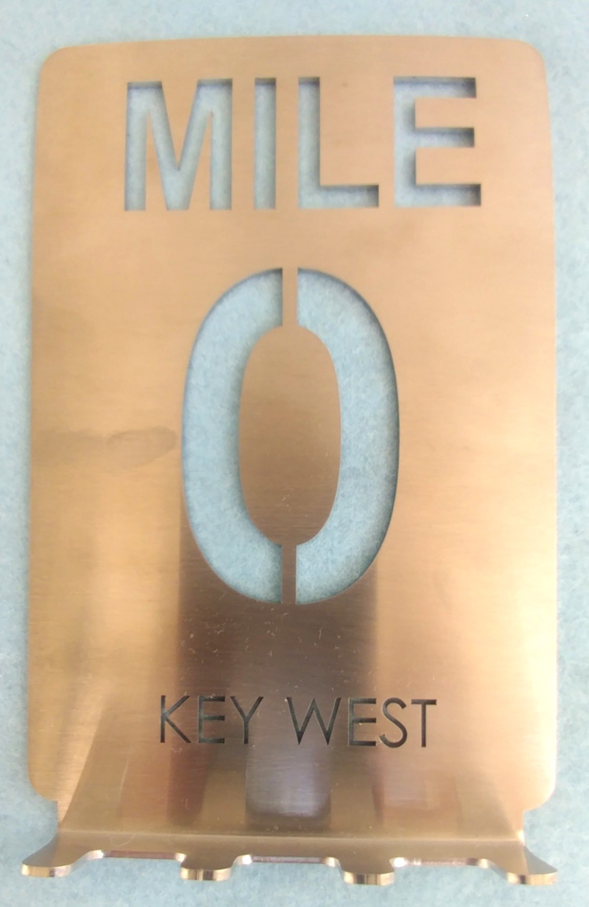 Unique Stainless Steel Key Rack holds spare keys, fobs, remotes: MILE 0 sign