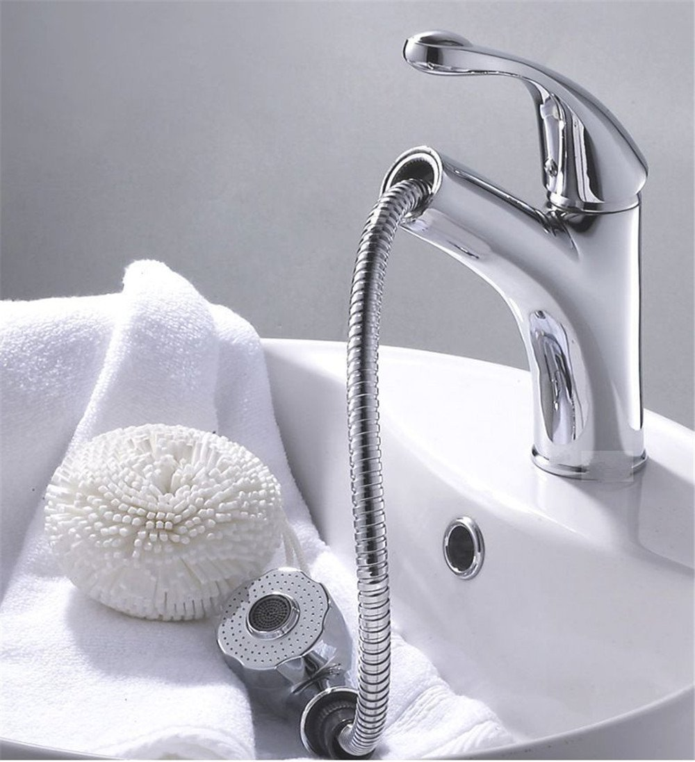A Sink mixer tap The hot and cold water mixing valve the copper bathtub the faucet the bathroom cabinet the pulling and pulling type chrome bath basin faucet. G