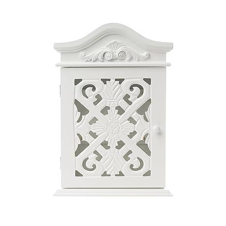 Caja de llaves con adornos y esculturas con la puerta en blanco de estilo antiguo campo de madera