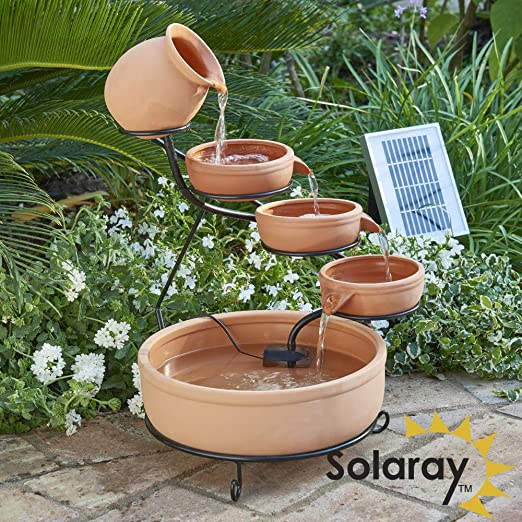 Fuente en cascada solar de Terracota: Amazon.es: Jardín