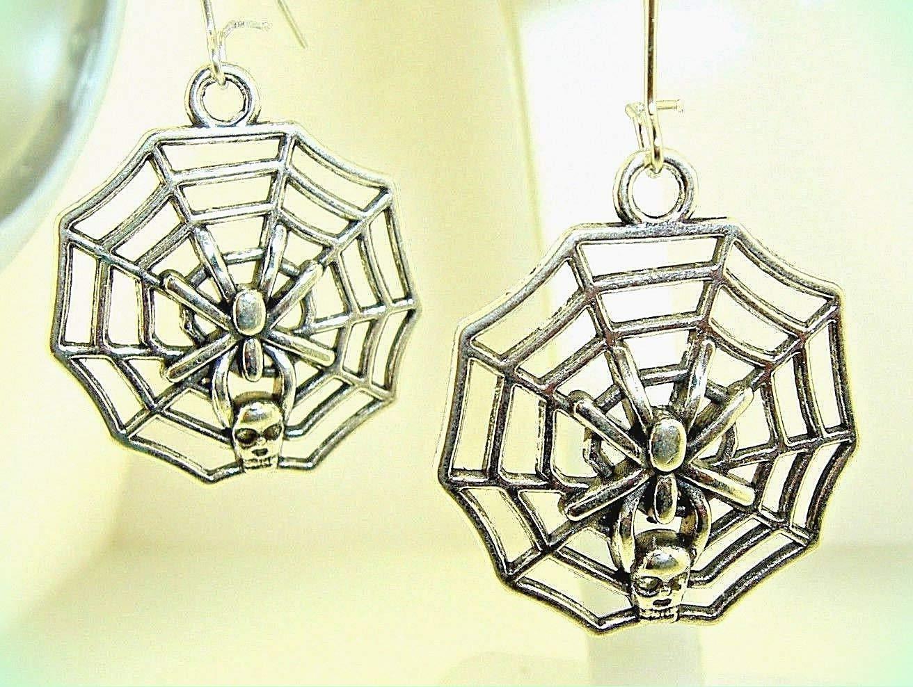 Spider in web teardrop earrings