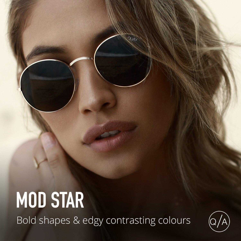 e61791d628 Amazon.com  Quay Australia MOD STAR Women s Sunglasses Vintage Small Round  - Black Green  Clothing