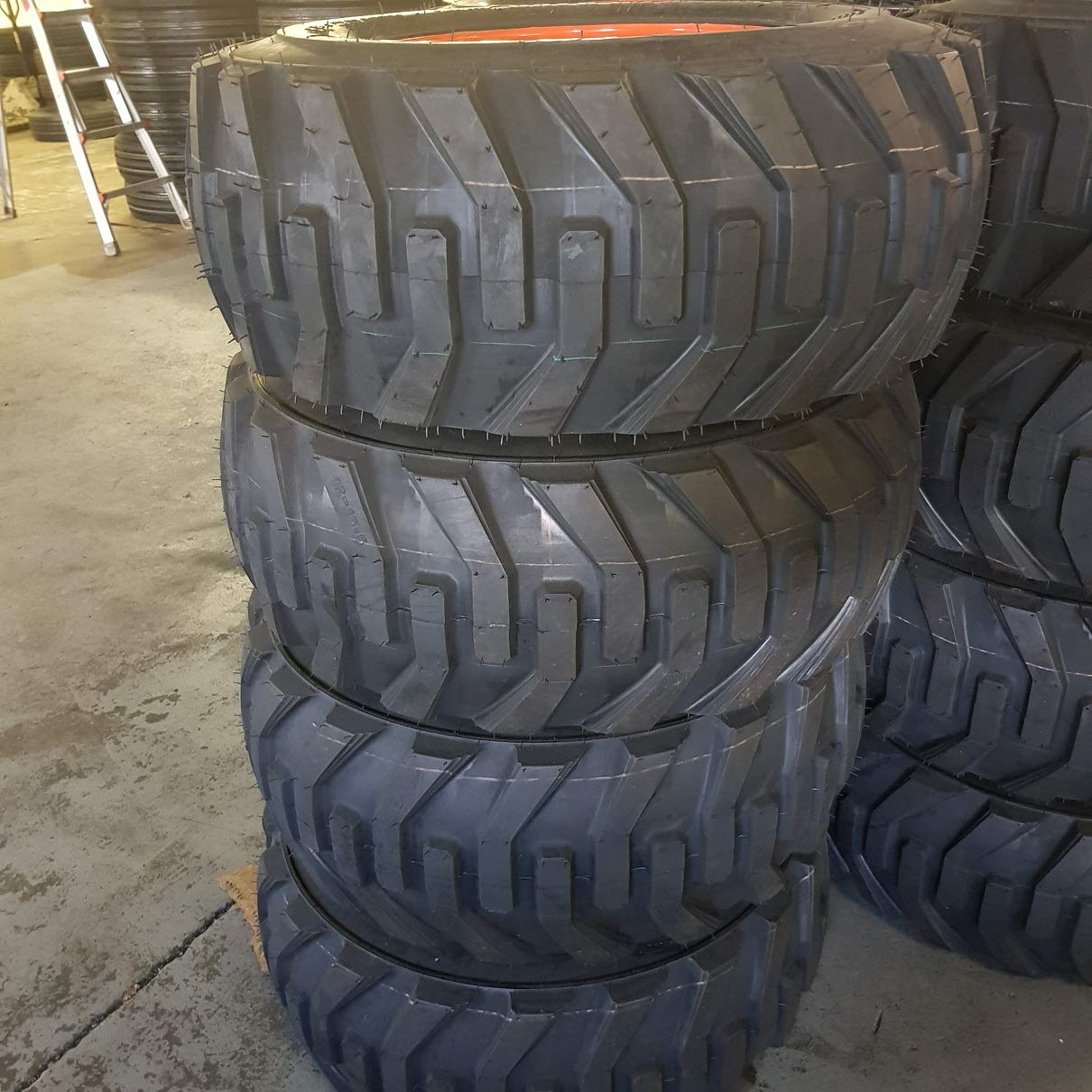 SET OF FOUR (4) 12-16.5 ROAD WARRIOR SKID STEER LOADER TIRE S with ORANGE Color Rims mounted, 12 PLY, NHS SKS 532-12x16.5 by Road Warrior